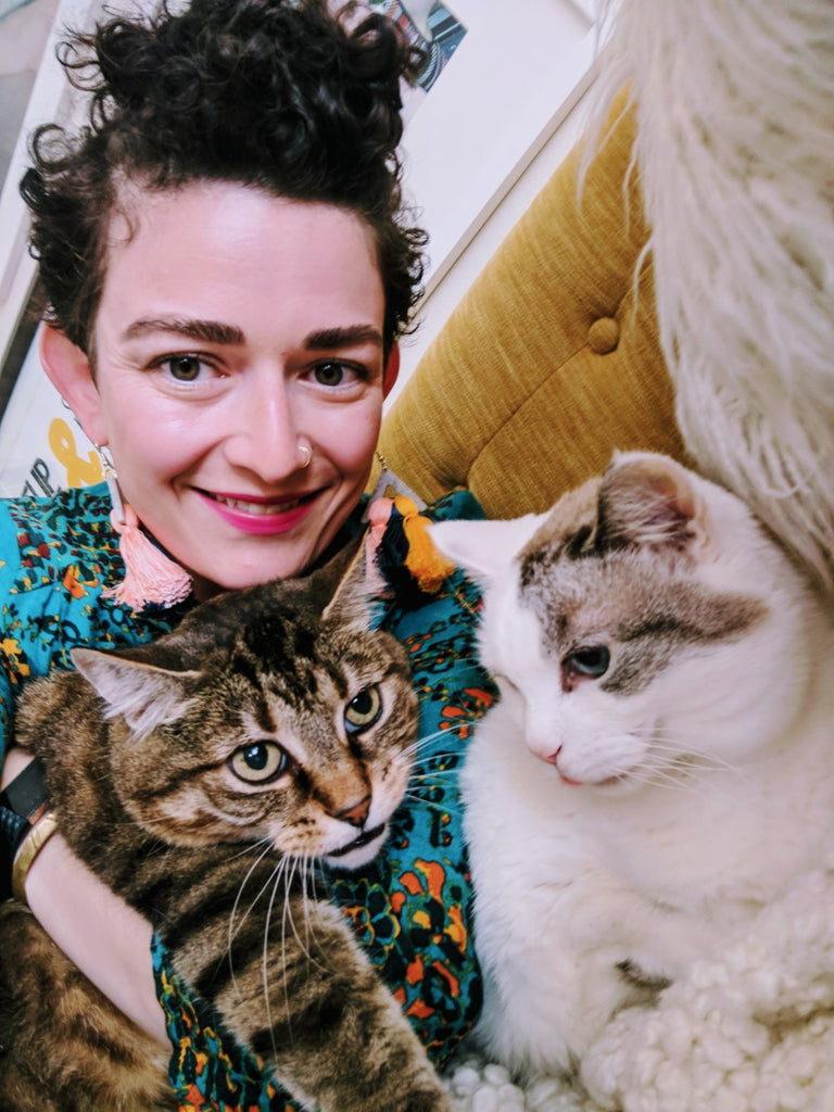 Adrianne with her two cats