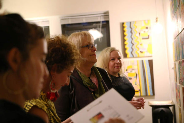 A woman looks at the artwork