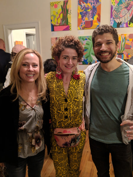 The artist poses with two friends