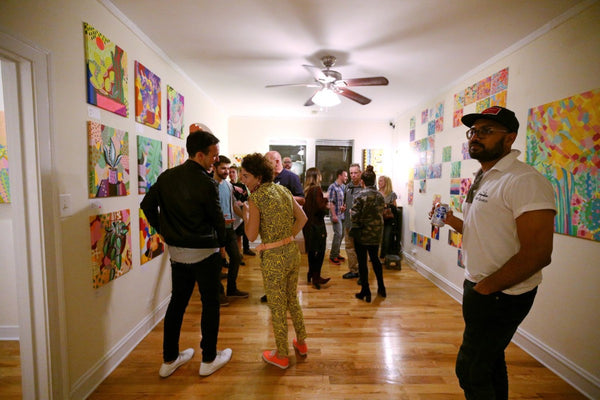 Guests admire the artwork as the party dies down