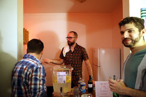 Seth bartending and talking to friends