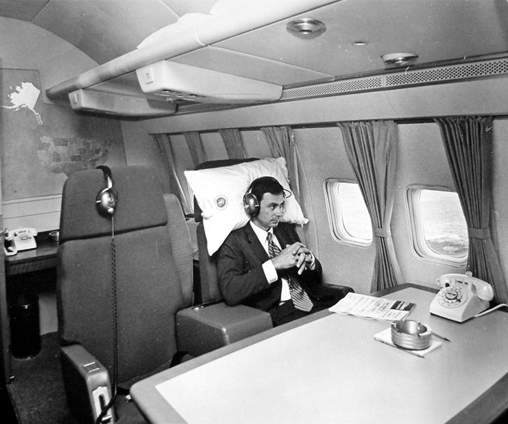 John C. Koss on Air Force One with headphones on