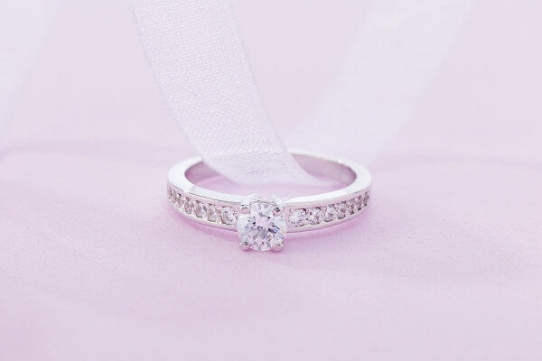 Silver-engagement-ring-on-pink-background