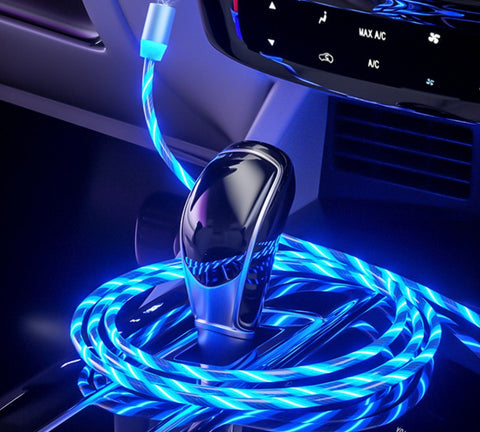 Blue Magnetic LED Phone charger Around A Black Gear Stick In A Car