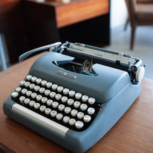 Load image into Gallery viewer, Smith Corona Clipper Typewriter (Steel Blue w/ white keys) - 056