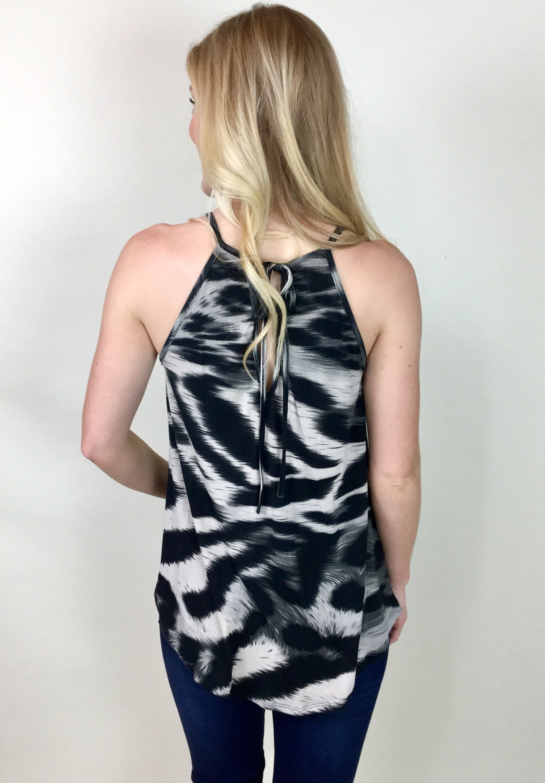 WILD ABOUT YOU SLEEVELESS TOP
