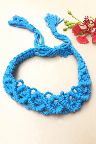 Make a statement with sustainable fashion accessory! This macrame headband is crafted intricately and will perfectly frame your beautiful face. It is adjustable and can be availed in an array of colors. Get yourself an assemblage of eco-friendly headbands.  Material : 100% Organic Cotton Thread  Craft : Macramé Colour : Blue  Measurements : Width - 1.5