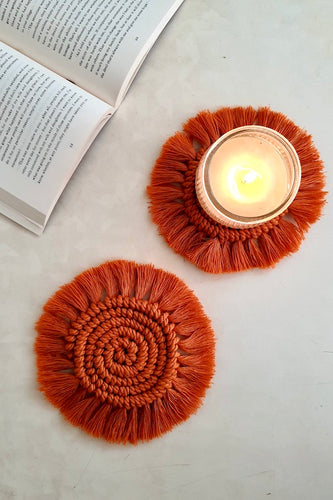 Macrame round fringe coasters made with hitch knots with organic cotton threads.