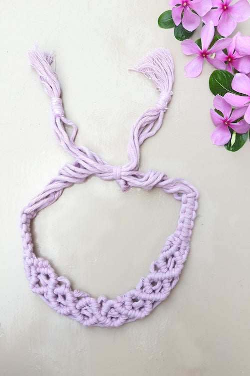 Make a statement with sustainable fashion accessory! This macrame headband is crafted intricately and will perfectly frame your beautiful face. It is adjustable and can be availed in an array of colors. Get yourself an assemblage of eco-friendly headbands.  Material : 100% Organic Cotton Thread  Craft : Macramé  Colour : Lavender  Measurements : Width - 1