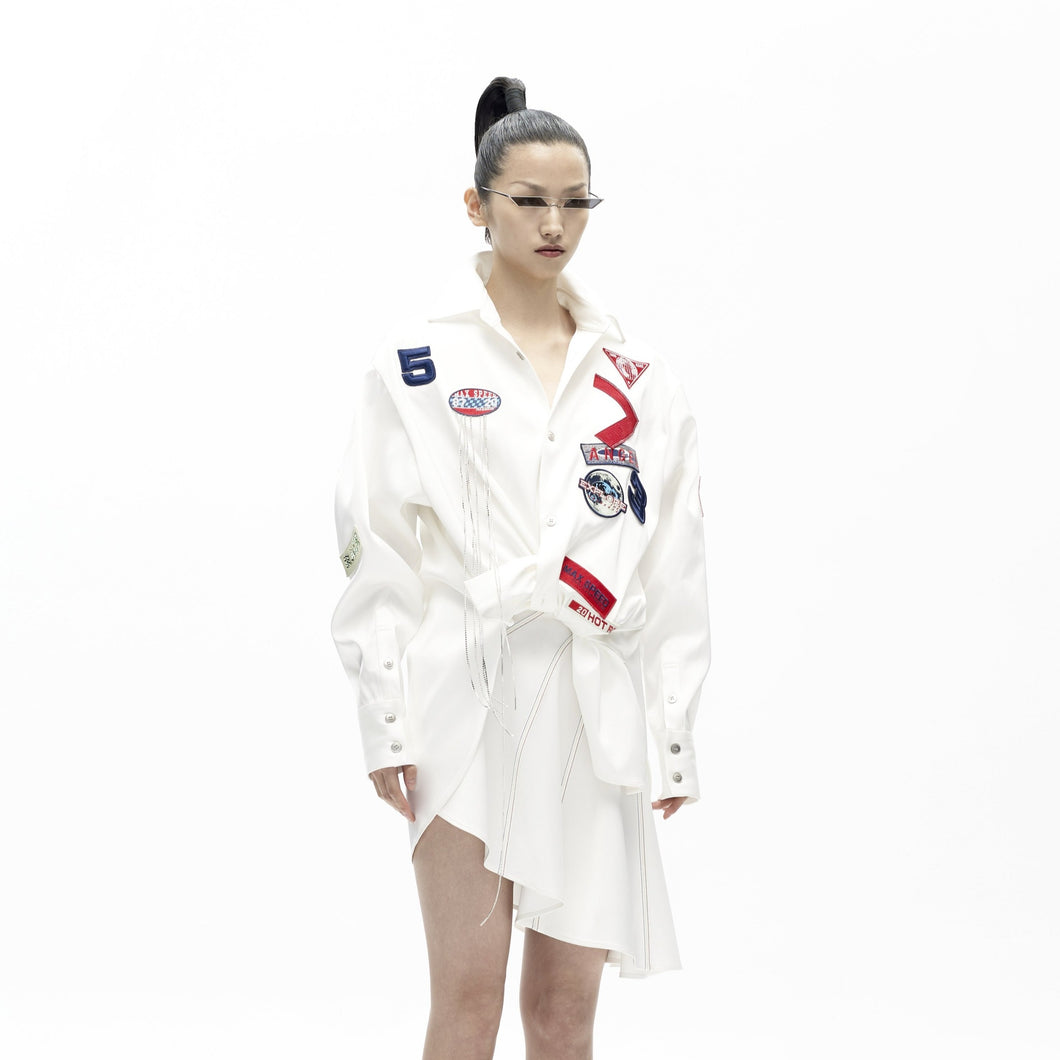 angel chen white slanted mini skirt with badges shirt outfit