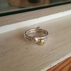 Sterling silver, 18c yellow gold, diamond, yellow sapphire