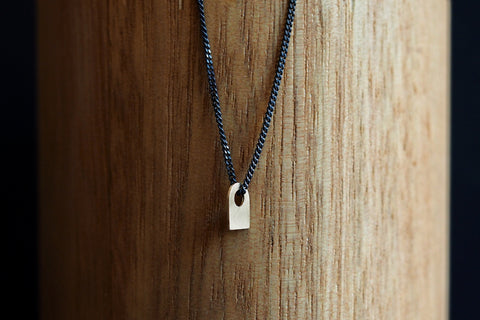'Ghost' Gold Pendant on Black Silver Chain