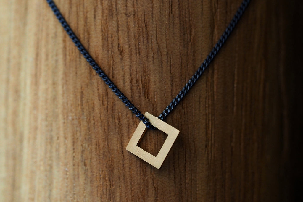 Square Tab Gold Pendant on Black Silver Chain