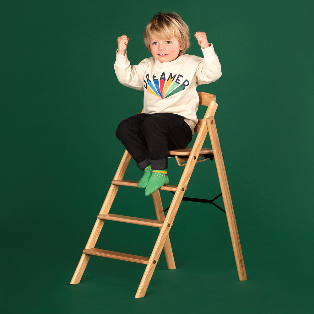 Klapp foldable high chair, inc safety rail. Natural oak