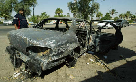 A burnt-out car in the aftermath of the Nisour Square massacre. Blackwater guards launched grenades into traffic.