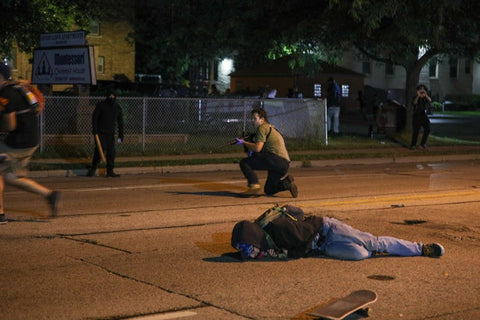 Anthony Huber lies in the street after having been shot in the chest