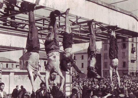 Mussolini (second from left) and his supporters hanging out at an Esso station in the Piazzale Loreto in Milan