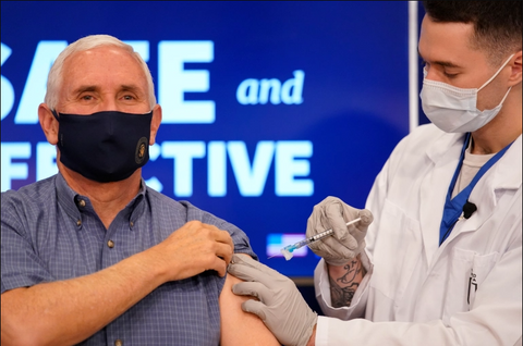 U.S. Vice President Mike Pence receives the Pfizer BioNTech vaccine at the White House