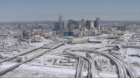 The snow-covered Dallas skyline lay dark for much of last week due to blackouts