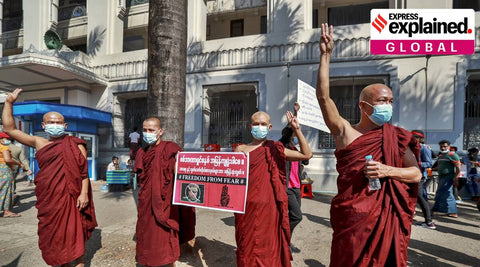 Buddhist monks toss out the Hunger Games salute in support of pro-democracy protests