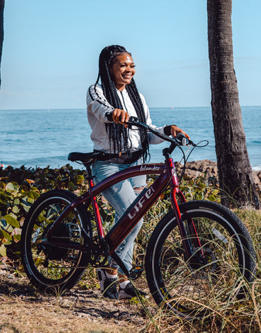 A girl riding a Islander 400 e-bike.