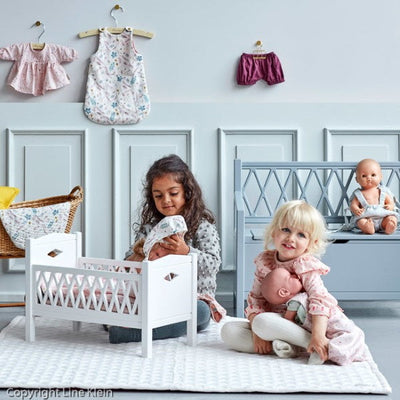 Little girls playing with Baby Dolls, Cam Cam Copenhagen Harlequin Cots Dolls Clothing