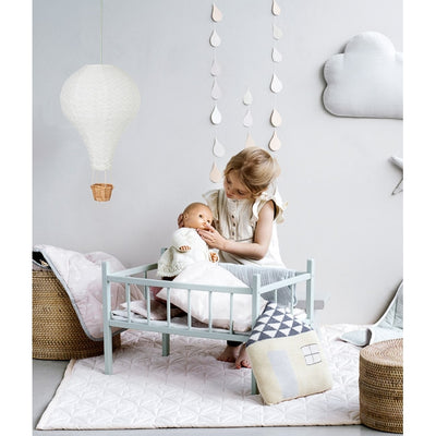Girl playing with Baby in Doll's Cot Bedding by Cam Cam in Grey Wave
