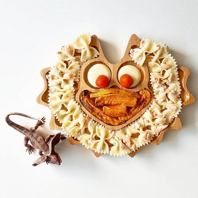 Styled food pic of Lizzie Frill Neck Lizard by Emondo Kids Bamboo Plate