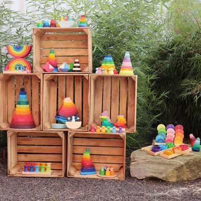 Grimm's Spiel Und Holz play stations with Stacking Rainbows, Semi Circles, Rainbow Friends, Pebbles, Double Rainbow and more
