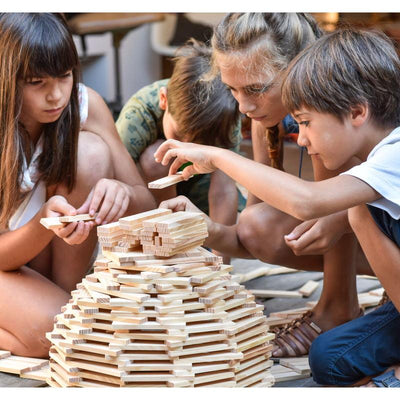 Children building structure using KAPLA wooden building planks