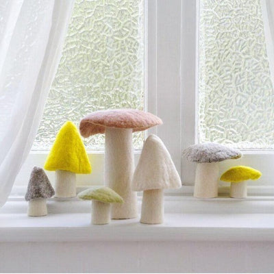 Arrangement of Muskhane Felted Wool Mushrooms on a windowsill