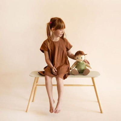 Olli Ella | Dinkum Doll | Pumpkin sitting on bench with girl