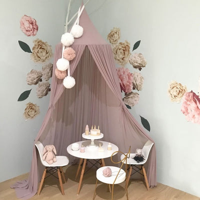 Spinkie Baby | Sheer Canopy | Old Rose styled with wall decals pom garlands table chairs