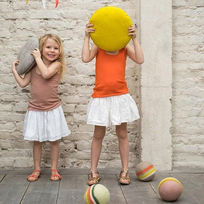 Two girls holding up Muskhane Smartie Cushions
