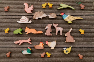 Collection of Ostheimer timber animals toys including Duckling