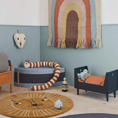 OYOY Living Design Follow the Rainbow Wall Rug styled in kids room with Lion Floor Rug