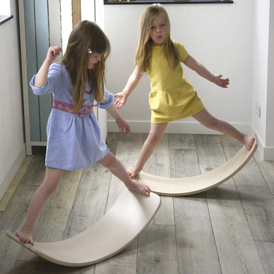 Two girls rocking on their Wobbel Balance Boards