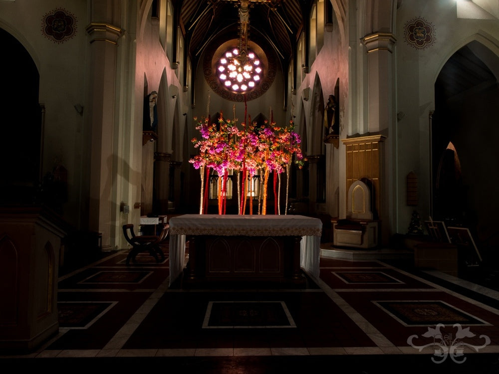 The rectilnear pattern on the floor of the high altar is repeated in the design with the placement of the birch trunks..