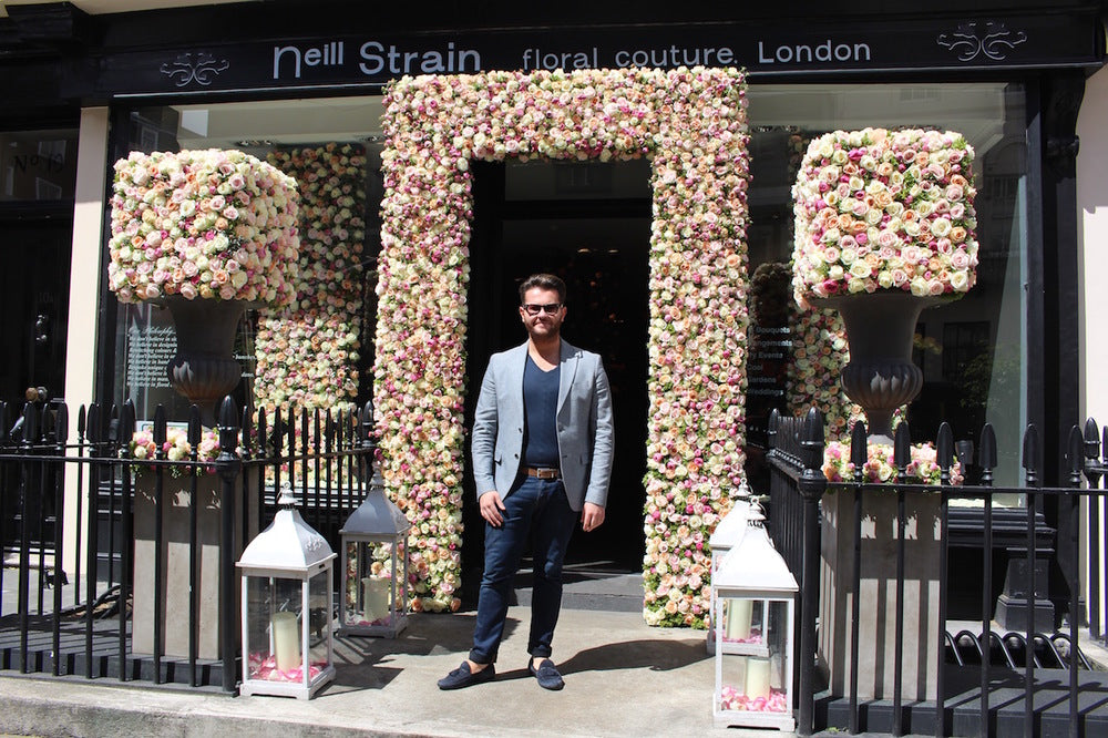 Neill Strain welcomes guests to A Celebration of the ROSE at The Flower Lounge for The Chelsea Flower Show