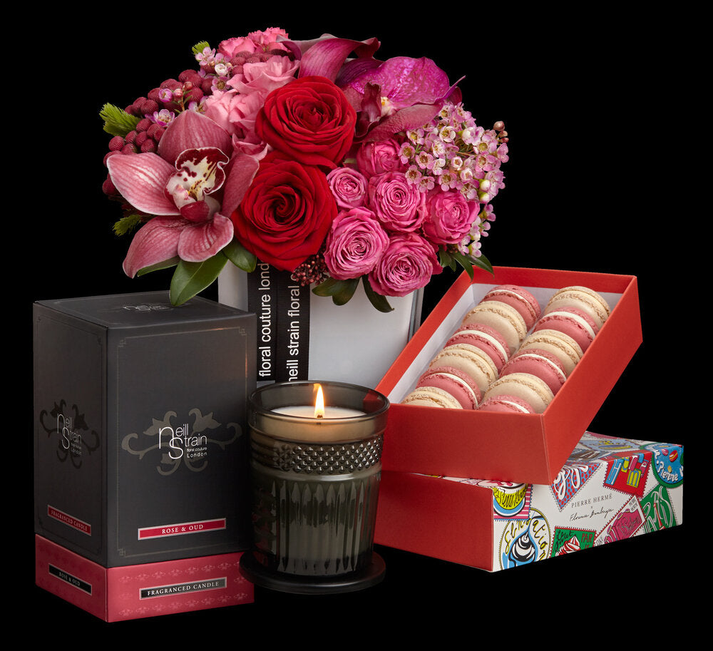 """Neill Strain Red Roses, """"Rose & Oud"""" fragranced candle and Macarons from Pierre HERME."""