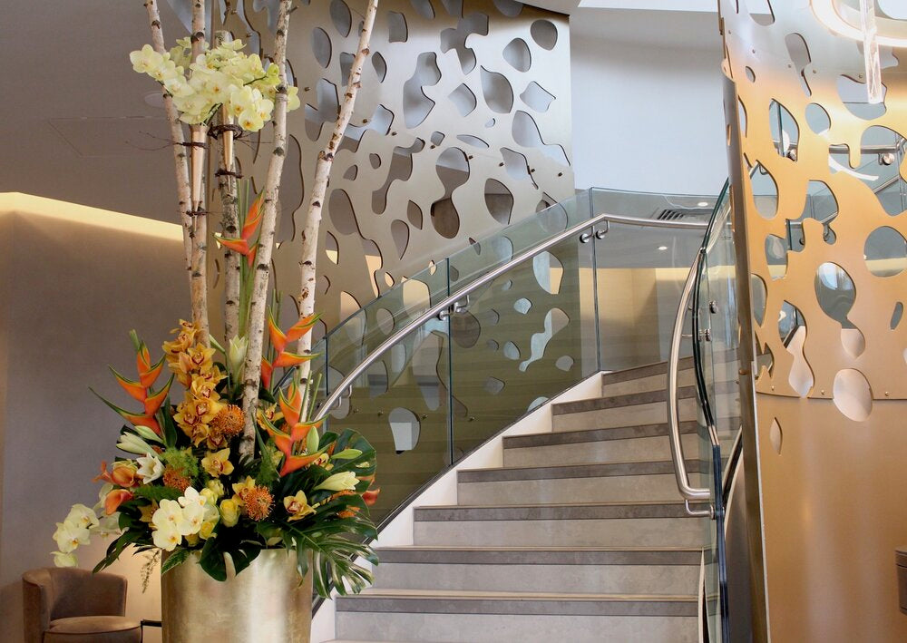 Majestic floral arrangement embellishes the magnificent staircase at the Novotel Leicester
