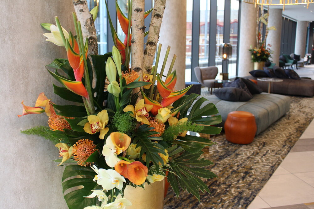 Neill's stunning floral arrangements decorate the Novotel Hotel lobby