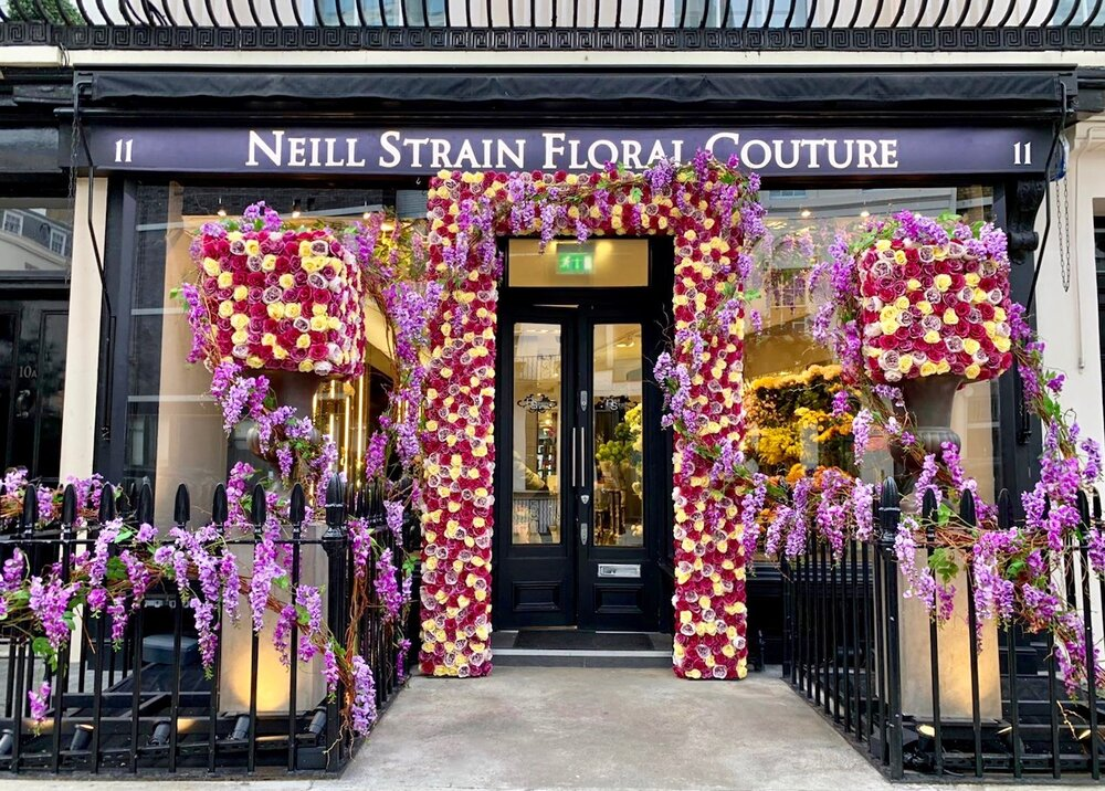 Spring display at Neill Strain Floral Couture with Roses and Wysteria