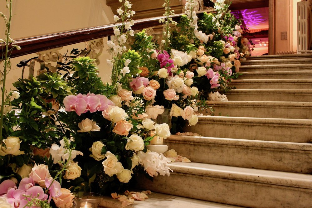 Upper staircase at One Belgravia designed by Neill Strain Floral Couture
