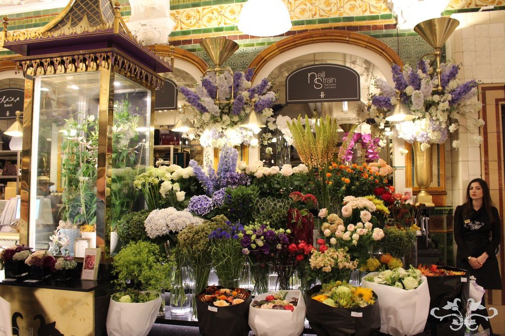 """Neill Strain Floral Couture concession at Harrods displaying the White Gloriosa """"Maria"""""""