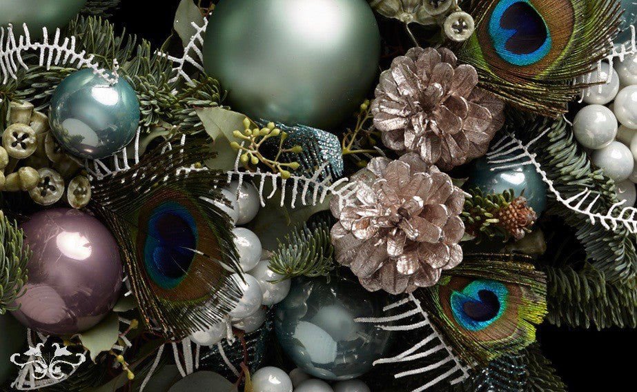 Peacock feathers add both eye-catching colour and texture to Christmas designs.