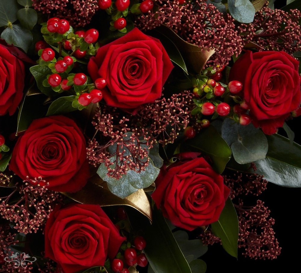 18, 24 and 48 Red Naomi Roses beautifully arranged in a glass vase make an impressive Valentine's gift.