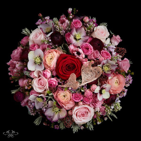 You can order on-line a bouquet of mixed blooms and a single red Rose for Valentine's Day. Deliveries in central and greater London.