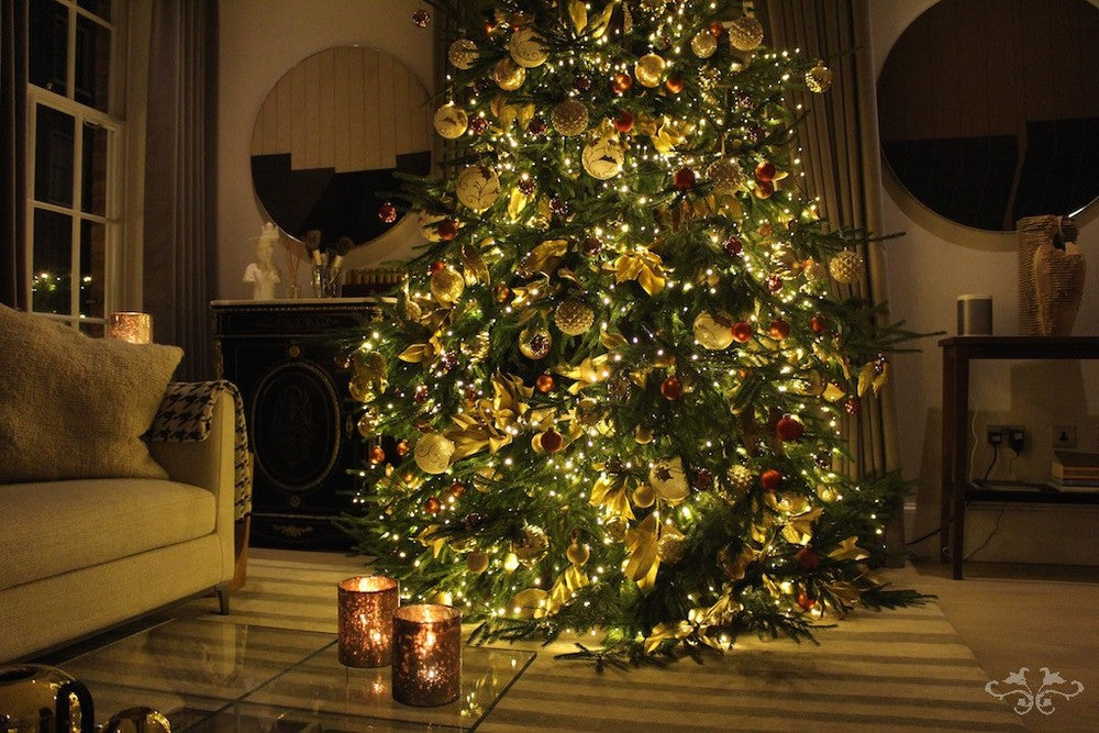 3.5 meter tall Christmas Tree lavishly decorated with golden Magnolia leaves, baubles and ribbons with a gold/cream/orange theme to complement the interiors. Photo: John Nassari