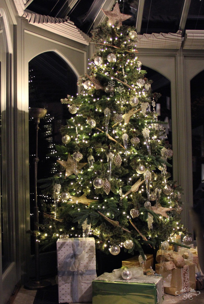 Neill Strain Christmas Tree richly decorated in silver with glass icicles, snowflakes and Birch stars.